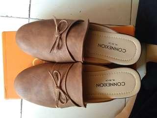 2 bulan yang lalu · Sepatu sandal slip on Connexion 2c581ac653