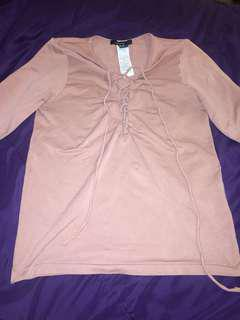 Pink long sleeve tied shirt