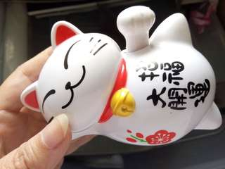 Waving Fortune Cat with solar panels