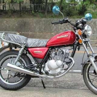 Suzuki Gn125 red motorcycle