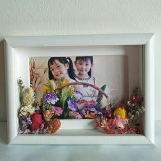Preserved rose in photo frame