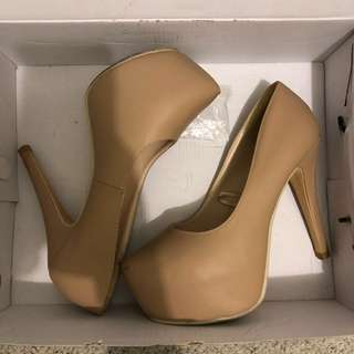 Nude stiletto pumps heels