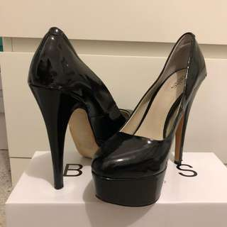 Black patent stiletto pump heels