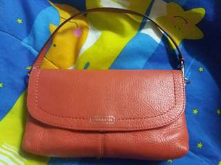 Coach wristlet coral color