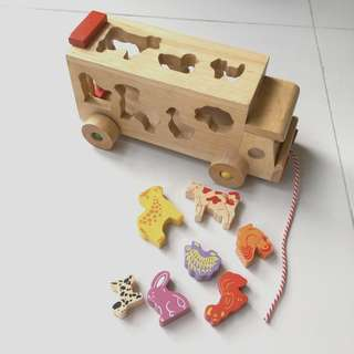 Wooden truck with wooden animals