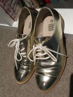 Seed Heritage gold shoes