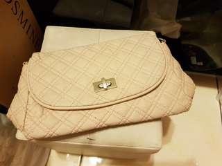 🚚 粉色格紋手拿包
