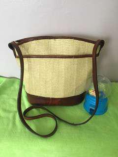 Leather/native sling bag