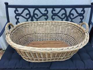 VERY OLD BASKET USED AS A BABY BASSINET