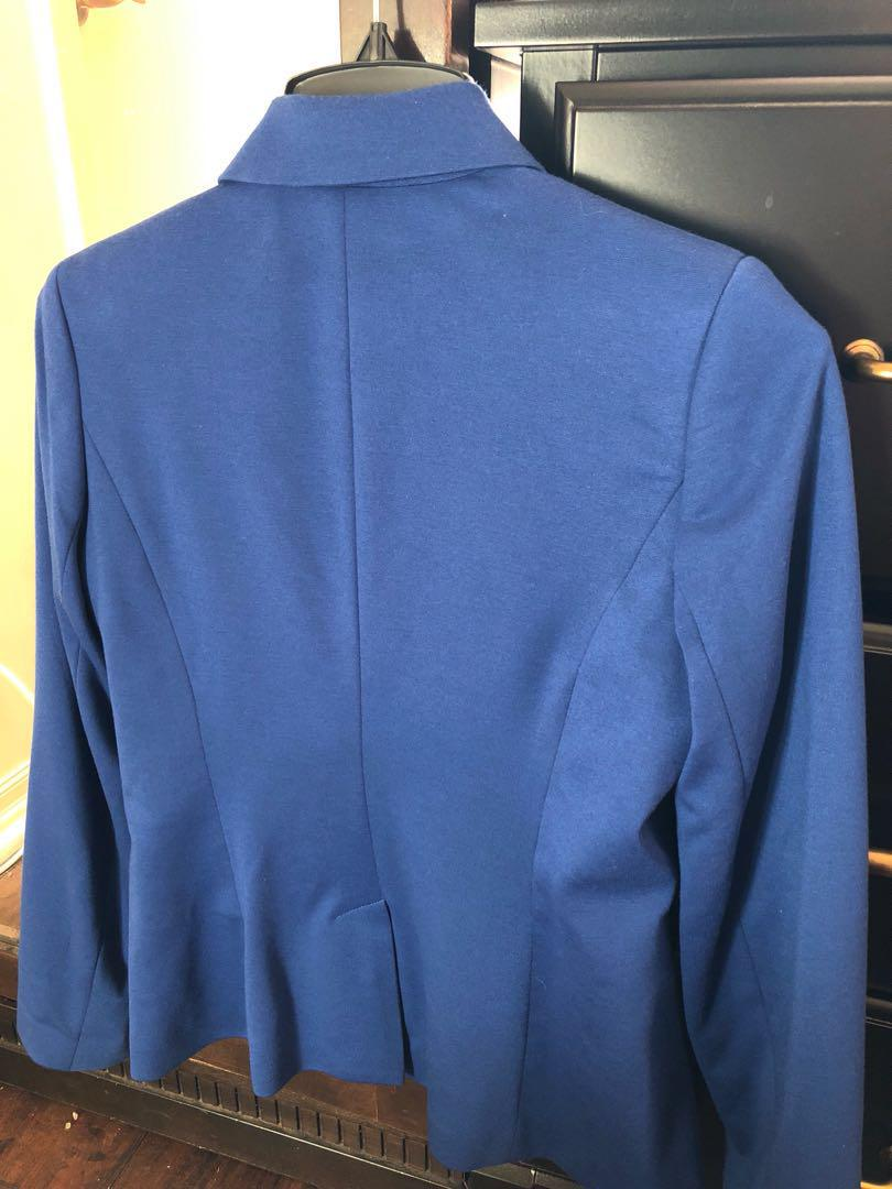 George size Medium can fit small. Good condition