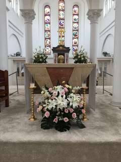 Altar Centerpieces in Lily Pink roses and Eustomas / Church Pews / Church Deco