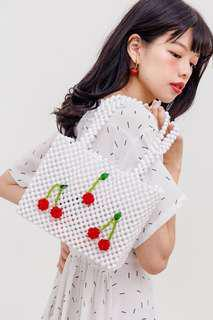 White beaded bag with cherries