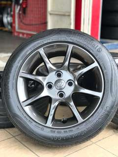 Original alza advance 15 inch sports rim bezza tyre 70%.