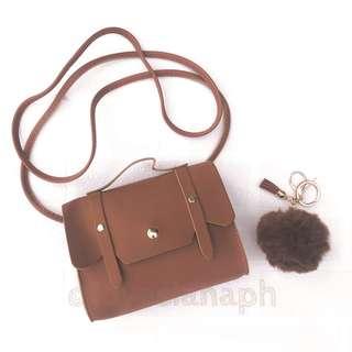 Hailey sling bag for kids (brown) + free fur ball
