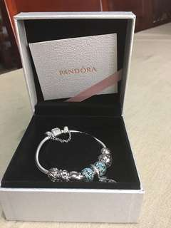 Pandora Bracelet 18cm with charms. Bought January1,2017. Good as new.