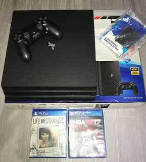 Ps4 pro with 6 games (2 cds and 4 digital) good as new with 2yrs spny warranty