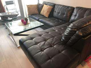 Elegant black leather sectional couch