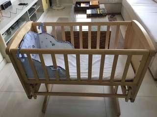 Well-loved Mothercare rocking wooden crib