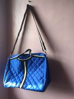 Blue quilted duffle bag