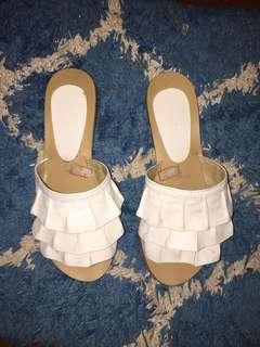 Ruffled white flat sandals