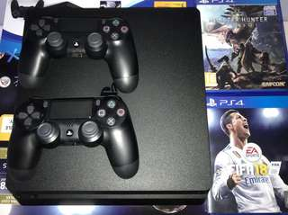 LIKE NEW Playstation 4 Slim with 2 controllers and games