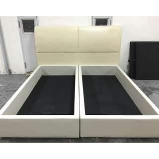 A cream  color leather new storage king size bed