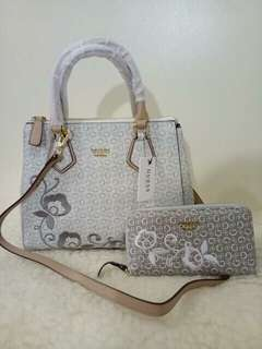 Original Guess bags at very affordable price | buy it as set or you can buy it as buy 1 take 1. It means 2 bags and 2 wallet