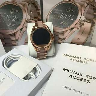 Authentic MK smart watch in rose gold