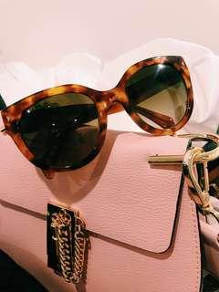 Prada Cat Eye tortoise shell sunglasses