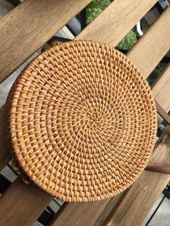 Brown rattan roundie bag simple design