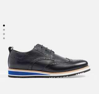Wingtip derby shoes in genuine soft leather