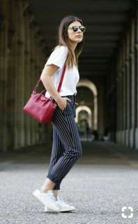 White top and black striped pants