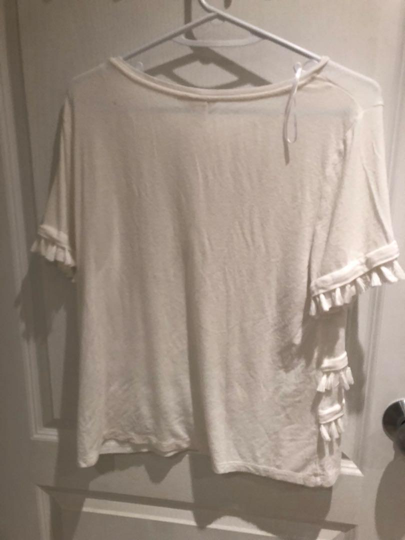 H&M white and gray fringe top. $20 each or 2 for $35