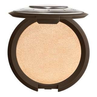 Becca highlighter Champagne Pop, moonstone, rose gold