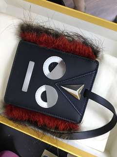 fendi monster face fur-trim luggage tag