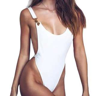 white bodysuit with gold clasp detail