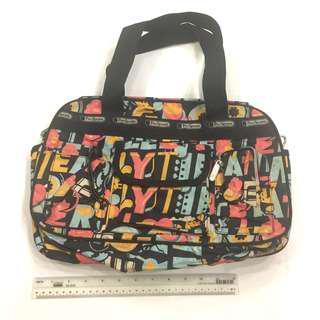 Graphic mini duffle sling bag