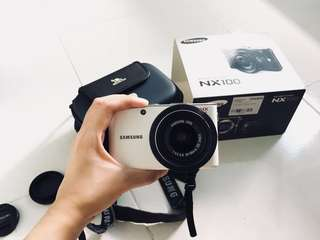 Samsung interchangeable lens camera NX 100 with 20-50mm lens