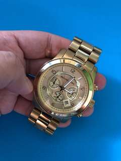 Preloved MK watch with minor flaw (few scratches)