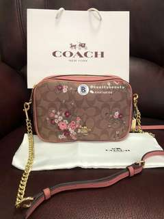 Coach Isla In signature canvas with floral bundle print
