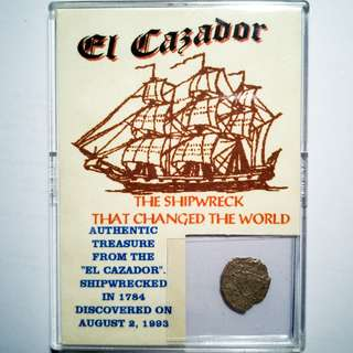 Shipwrecked silver Spanish 1/2 Reale, retrieved from El Cazador