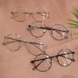 橢圓框特殊裸空腳架造型中性眼鏡
