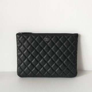 Authentic Chanel O Case Medium