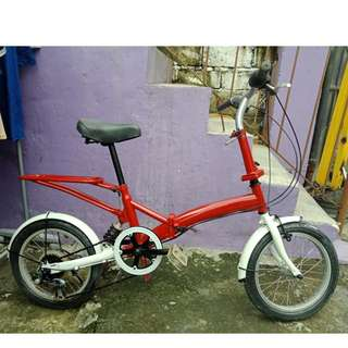 RED WITH SUSPENSION FOLDING BIKE (FREE DELIVERY AND NEGOTIABLE!)