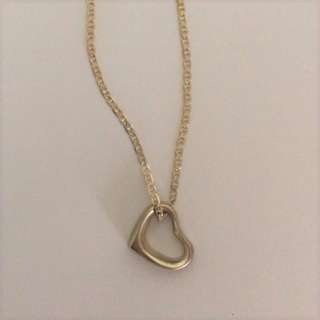 Silver heart-shaped pendant with necklace chain