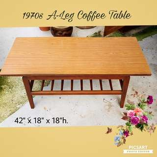 1970s Pencil-Leg Coffee Table. Mixture of Teak and Solidwood Material. Good Condition, only the formica laminate is little loose at the edge and you can use super-glue to stick it back. $48 Clearance offer. Sms 96337309 for fast deal.