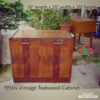 1950s Teakwood Sideboard or Cabinet. Ok Condition, it has stains and wear and tear due to age and is not refurbished. View to buy, $48 Clearance offer. Sms 96337309 for fast deal.