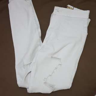 Broken white ripped jeans
