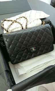 Chanel Classic Caviar Flap bag with Gold Chain