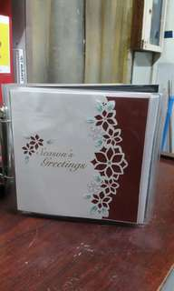 Assortment of christmas and chinese new yr greeting cards